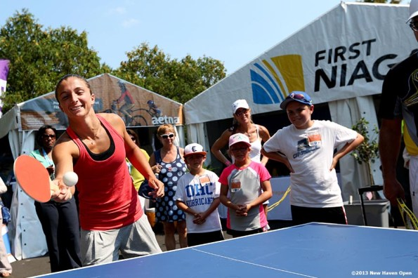 """""""Sara Errani plays a game of table tennis after an autograph session on Day 5 of the New Haven Open at Yale University in New Haven, Connecticut Tuesday, August 20, 2013."""""""