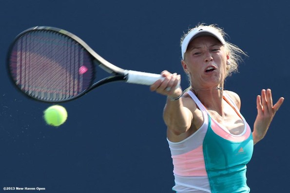 """""""Caroline Wozniacki connects on a forehand on Day 6 of the New Haven Open at Yale University in New Haven, Connecticut Wednesday, August 20, 2013."""""""