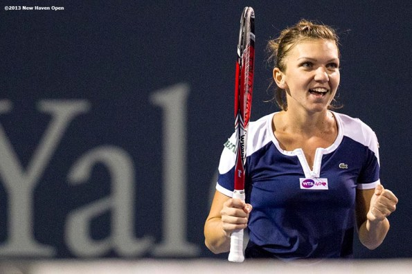"""""""Simona Halep reacts after defeating Caroline Wozniacki in the semi-finals on Day 8 of the New Haven Open at Yale University in New Haven, Connecticut Friday, August 20, 2013."""""""