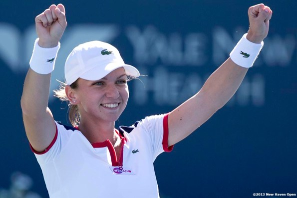 """""""Simona Halep reacts after winning championship point to defeat Petra Kvitova in the finals of the New Haven Open at Yale University in New Haven, Connecticut Saturday, August 24, 2013."""""""