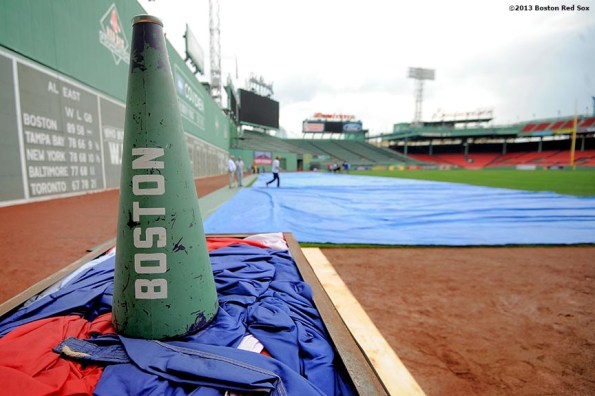 """""""The loudspeaker of John Coyne, US Flag Coordinator of the Boston Red Sox, is shown as members of the Red Sox Front Office help roll an American Flag in preparation for a 9/11 memorial flag drop over the Green Monster Friday, September 13, 2013 at Fenway Park in Boston, Massachusetts."""""""
