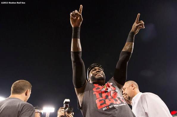 """""""Boston Red Sox designated hitter David Ortiz celebrates after the Red Sox clinched the American League East title with a 6-3 win over the Toronto Blue Jays Friday, September 20, 2013 at Fenway Park."""""""