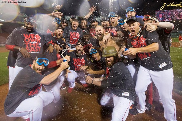 """""""Boston Red Sox teammates pose for a photograph on the pitcher's mound during an on-field celebration after the Red Sox clinched the American League East title with a 6-3 win over the Toronto Blue Jays Friday, September 20, 2013 at Fenway Park."""""""