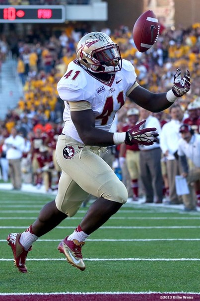 """""""Florida State Seminoles fullback Chad Abrams secures the ball as he scores a touchdown during the third quarter of a game against the Boston College Eagles at Alumni Stadium in Chestnut Hill, Massachusetts Saturday, September 28, 2013."""""""