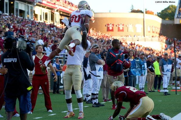 """""""Florida State Seminoles wide receiver Rashad Greene celebrates after scoring a touchdown during the third quarter of a game against the Boston College Eagles at Alumni Stadium in Chestnut Hill, Massachusetts Saturday, September 28, 2013."""""""