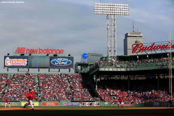 """""""Boston Red Sox pitcher Jon Lester delivers during the first inning of Game One of the American League Division Series against the Tampa Bay Rays Friday, October 4, 2013 at Fenway Park in Boston, Massachusetts."""""""