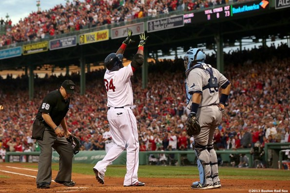 """""""Boston Red Sox designated hitter David Ortiz celebrates after hitting a home run during the first inning of game two of the American League Division Series against the Tampa Bay Rays Saturday, October 5, 2013 at Fenway Park in Boston, Massachusetts."""""""