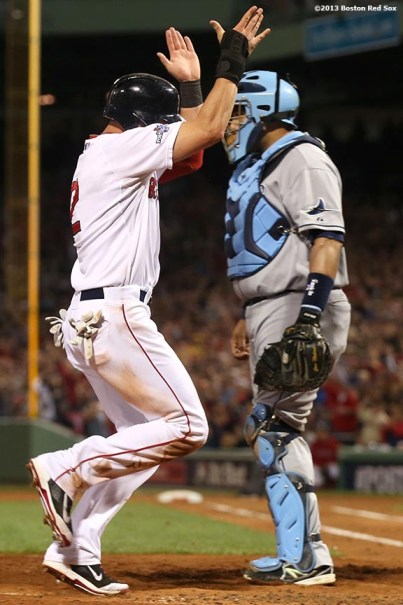 """""""Boston Red Sox center fielder Jacoby Ellsbury celebrates as he scores on an RBI double by Dustin Pedroia during the fifth inning of game two of the American League Division Series against the Tampa Bay Rays Saturday, October 5, 2013 at Fenway Park in Boston, Massachusetts."""""""