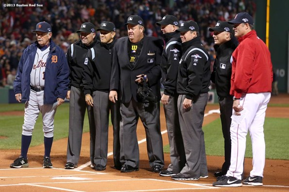 """""""The umpiring crew, Detroit Tigers manager Jim Leyland and Boston Red Sox manager John Farrell pose for a photograph during a pre-game ceremony before game one of the American League Championship Series between the Boston Red Sox and the Detroit Tigers Saturday, October 12, 2013 at Fenway Park in Boston, Massachusetts."""""""