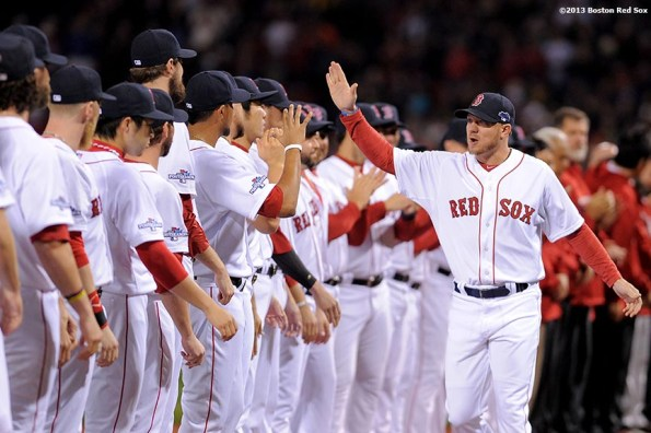 """""""Boston Red Sox pitcher Jake Peavy high fives teammates during a pre-game ceremony before game one of the American League Championship Series between the Boston Red Sox and the Detroit Tigers Saturday, October 12, 2013 at Fenway Park in Boston, Massachusetts."""""""