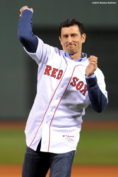 """""""Former Boston Red Sox shortstop Nomar Garciaparra throws out the ceremonial first pitch before game one of the American League Championship Series between the Boston Red Sox and the Detroit Tigers Saturday, October 12, 2013 at Fenway Park in Boston, Massachusetts."""""""