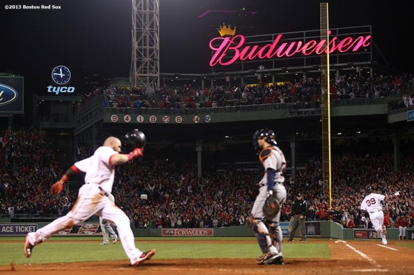 """""""Boston Red Sox catcher Jarrod Saltalamacchia (right) celebrates after hitting a game-winning walk off RBI single to score left fielder Jonny Gomes during the ninth inning of game two of the American League Championship Series against the Detroit Tigers Sunday, October 13, 2013 at Fenway Park in Boston, Massachusetts. The Red Sox came back from a 5-0 deficit to defeat the Tigers 6-5."""""""