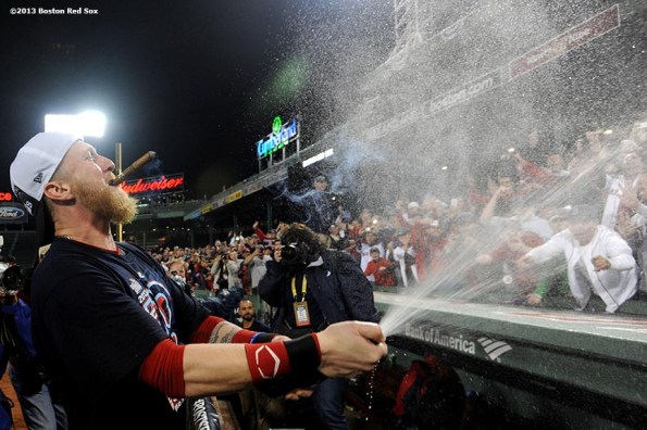 """""""Boston Red Sox outfielder Mike Carp sprays Champagne during an on-field celebration after winning game six of the American League Championship Series against the Detroit Tigers and advancing to the World Series Saturday, October 19, 2013 at Fenway Park in Boston, Massachusetts."""""""