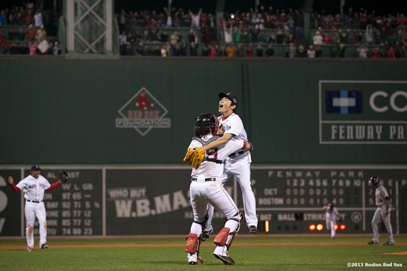 """""""Boston Red Sox pitcher Koji Uehara and catcher Jarrod Saltalamacchia celebrate after winning game six of the American League Championship Series against the Detroit Tigers and advancing to the World Series Saturday, October 19, 2013 at Fenway Park in Boston, Massachusetts."""""""