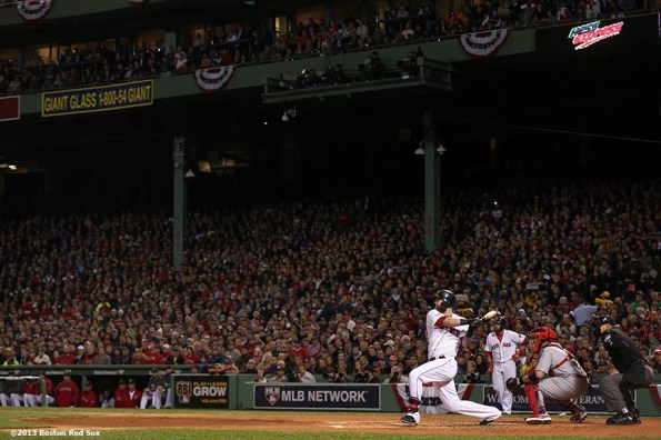 """""""Boston Red Sox first baseman Mike Napoli hits a bases clearing RBI double during the first inning of game one of the 2013 World Series against the St. Louis Cardinals Wednesday, October 23, 2013 at Fenway Park in Boston, Massachusetts."""""""