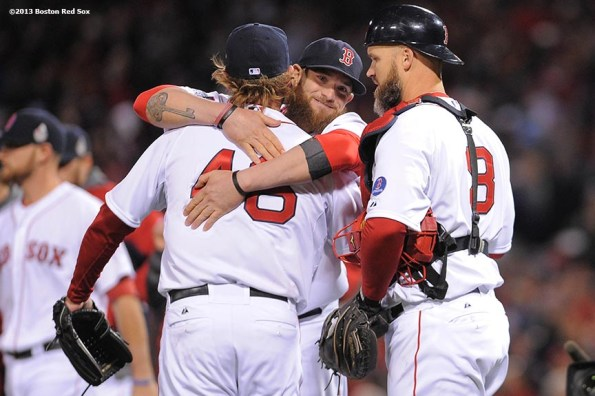 """""""Boston Red Sox left fielder Jonny Gomes hugs pitcher Ryan Dempster after winning game one of the 2013 World Series against the St. Louis Cardinals Wednesday, October 23, 2013 at Fenway Park in Boston, Massachusetts."""""""