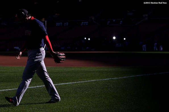 """""""Boston Red Sox pitcher Junichi Tazawa walks toward left field before game three of the 2013 World Series against the St. Louis Cardinals Saturday, October 26, 2013 at Busch Stadium in St. Louis, Missouri."""""""