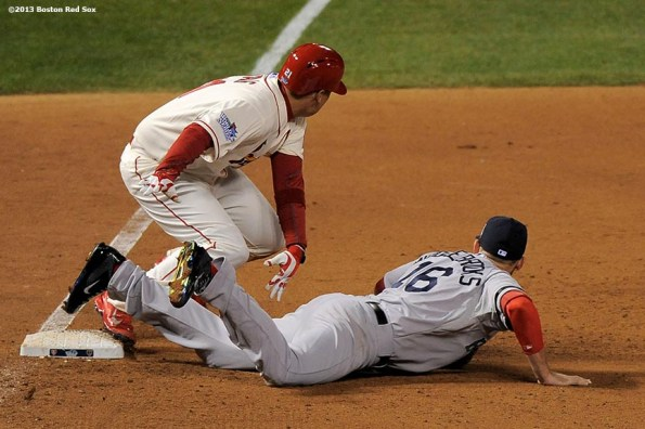 """""""Boston Red Sox third baseman Will Middlebrooks is called for an interference error as St. Louis Cardinals infielder Allen Craig runs toward home to score the game winning run during the ninth inning of game three of the 2013 World Series  Saturday, October 26, 2013 at Busch Stadium in St. Louis, Missouri."""""""