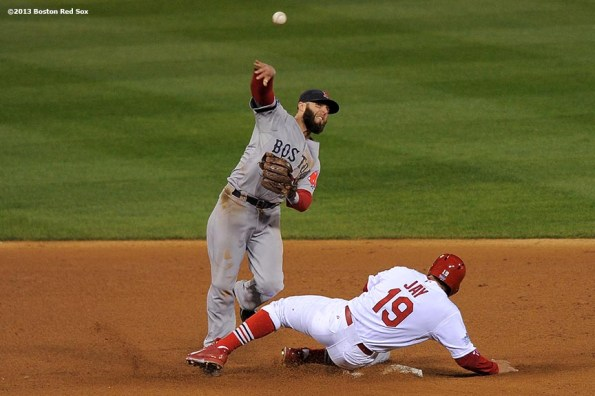 """""""Boston Red Sox second baseman Dustin Pedroia turns a double play over center fielder John Jay during the fourth inning of game four of the 2013 World Series against the St. Louis Cardinals Sunday, October 27, 2013 at Busch Stadium in St. Louis, Missouri."""""""