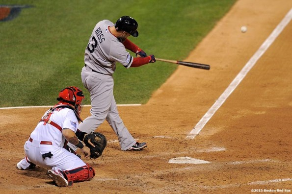 """""""Boston Red Sox catcher David Ross hits a go-ahead RBI double during the seventh inning of game five of the 2013 World Series against the St. Louis Cardinals Monday, October 28, 2013 at Busch Stadium in St. Louis, Missouri."""""""