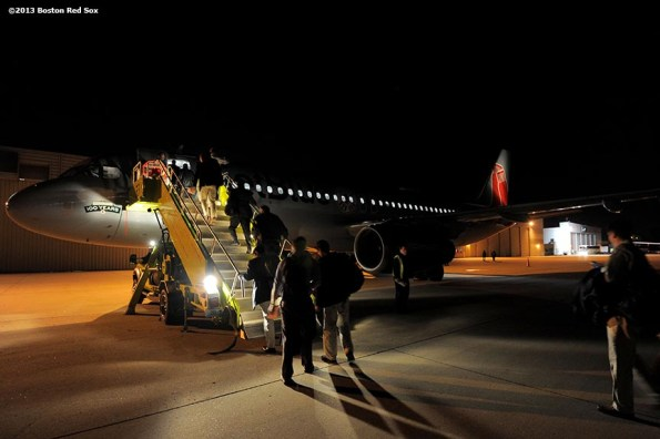 """""""Members of the Boston Red Sox front office board an airplane at Lambert-St. Louis International Airport in St. Louis, Missouri Tuesday, October 29, 2013 after game four of the 2013 World Series between the Boston Red Sox and the St. Louis Cardinals."""""""