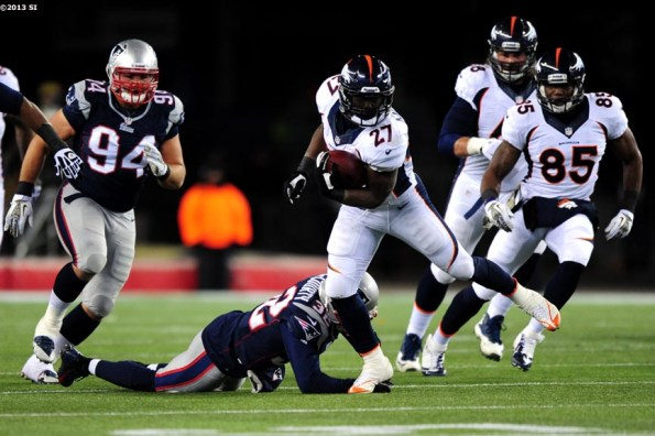 """""""Denver Broncos running back Knowshon Moreno carries the ball during a game against the New England Patriots Sunday, November 24, 2013 at Gillette Stadium in Foxborough, Massachusetts."""""""