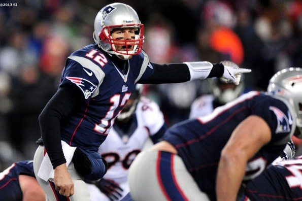 """""""New England Patriots quarterback Tom Brady calls plays at the line of scrimmage during a game against the Denver Broncos Sunday, November 24, 2013 at Gillette Stadium in Foxborough, Massachusetts."""""""