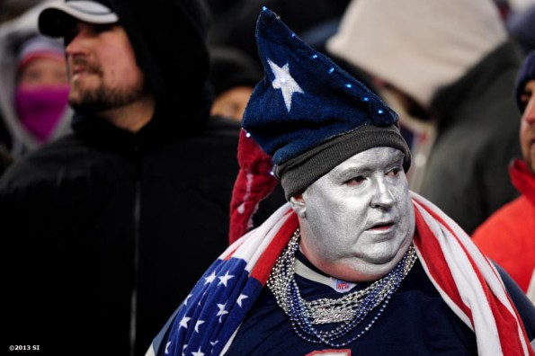 """""""A New England Patriots fan reacts during a game against the Denver Broncos Sunday, November 24, 2013 at Gillette Stadium in Foxborough, Massachusetts."""""""