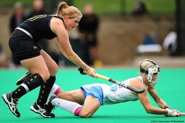 """""""University of Maryland defender Sarah Sprink defends University of North Carolina back Abby Frey during the ACC Field Hockey Conference Championship game Sunday, November 10, 2013 at Boston College in Newton, Massachusetts."""""""