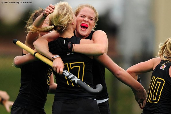 """""""University of Maryland defender Sarah Sprink celebrates with teammates after Maryland scored a goal during the ACC Field Hockey Conference Championship game against the University of North Carolina Sunday, November 10, 2013 at Boston College in Newton, Massachusetts."""""""