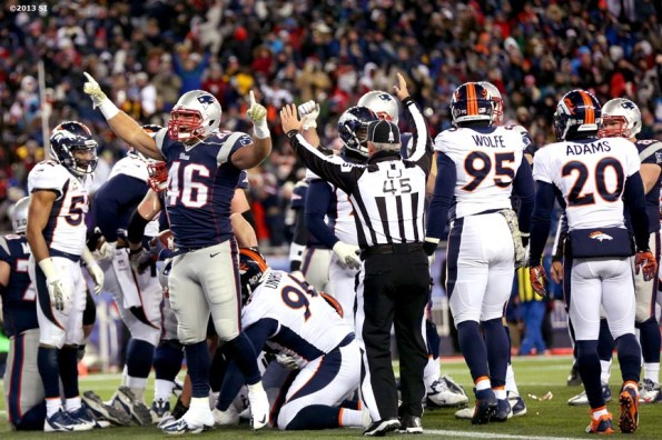 """""""New England Patriots full back James Develin celebrates after the Patriots scored a touchdown against the Denver Broncos Sunday, November 24, 2013 at Gillette Stadium in Foxborough, Massachusetts."""""""