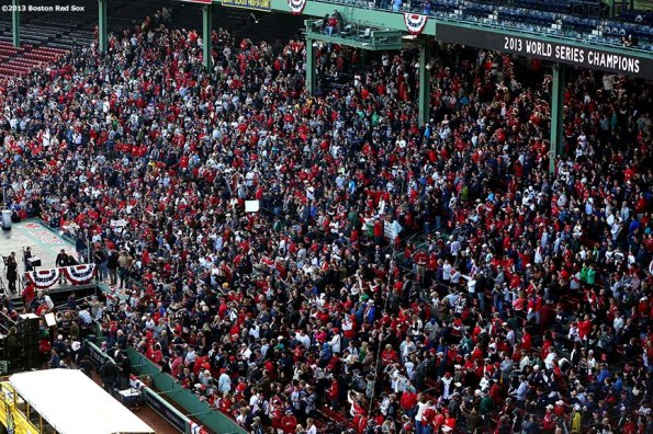 """""""Boston Red Sox fans gather at Fenway Park before the Rolling Rally World Series Championship Parade through downtown Boston, Massachusetts Saturday, November 2, 2013."""""""