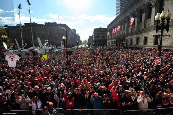 """""""Fans in Copley Square cheer during the Rolling Rally World Series Championship Parade through downtown Boston, Massachusetts Saturday, November 2, 2013."""""""