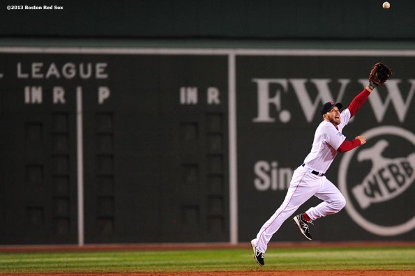 """"""" Boston Red Sox shortstop Stephen Drew lunges for a ball during the third inning of game six of the 2013 World Series against the St. Louis Cardinals Wednesday, October 30, 2013 at Fenway Park in Boston, Massachusetts."""""""