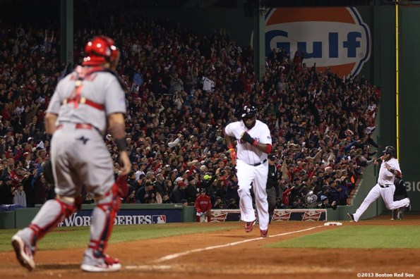 """""""Boston Red Sox first baseman Mike Napoli and designated hitter David Ortiz score on an RBI single by right fielder Shane Victorino during the fourth inning of game six of the 2013 World Series against the St. Louis Cardinals Wednesday, October 30, 2013 at Fenway Park in Boston, Massachusetts."""""""