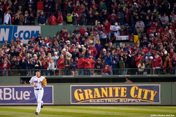 """""""Boston Red Sox pitcher Koji Uehara jogs from the bullpen during the ninth inning of game six of the 2013 World Series against the St. Louis Cardinals Wednesday, October 30, 2013 at Fenway Park in Boston, Massachusetts."""""""