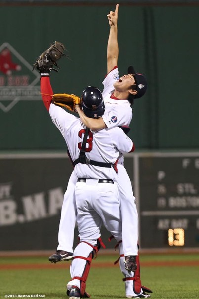 """""""Boston Red Sox pitcher Koji Uehara and catcher David Ross react after recording the final out to defeat the St. Louis Cardinals 6-1 to win the 2013 World Series Wednesday, October 30, 2013 at Fenway Park in Boston, Massachusetts."""""""
