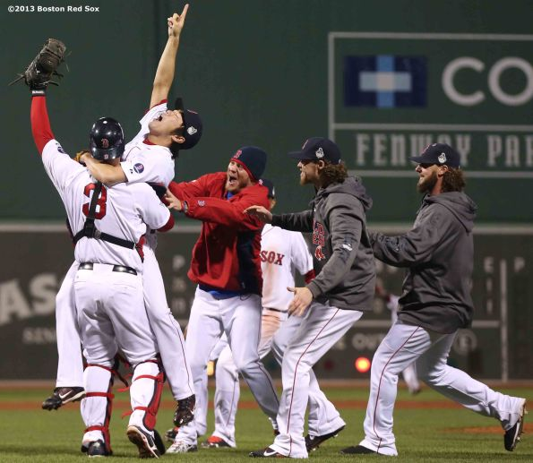 """""""Boston Red Sox pitcher Koji Uehara, catcher David Ross, and teammates react after recording the final out to defeat the St. Louis Cardinals 6-1 to win the 2013 World Series Wednesday, October 30, 2013 at Fenway Park in Boston, Massachusetts."""""""