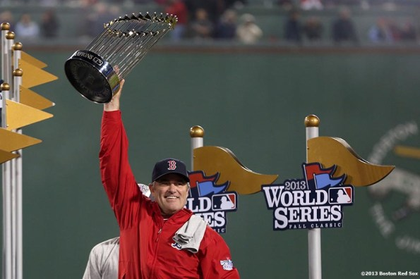 """""""Boston Red Sox manager John Farrell raises the World Series trophy  after defeating the St. Louis Cardinals 6-1 to win the 2013 World Series Wednesday, October 30, 2013 at Fenway Park in Boston, Massachusetts."""""""