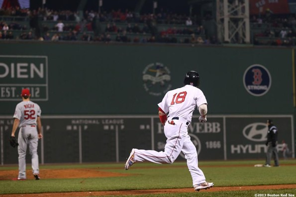 """""""Boston Red Sox right fielder Shane Victorino rounds the bases after hitting a three-RBI double during the third inning of game six of the 2013 World Series against the St. Louis Cardinals Wednesday, October 30, 2013 at Fenway Park in Boston, Massachusetts."""""""