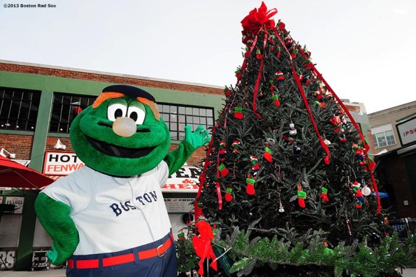 """""""Boston Red Sox mascot Wally the Green Monster poses with a christmas tree during the annual Christmas at Fenway celebration Saturday, December 14, 2013, which featured speaking appearances and autograph sessions with players and coaches, holiday themed attractions and decorations, and opportunities for fans to purchase tickets for the 2014 season."""""""