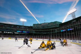 """""""Providence College and Merrimack College play each other in the first period of a game at Frozen Fenway Saturday, January 4, 2014 at Fenway Park in Boston, Massachusetts."""""""