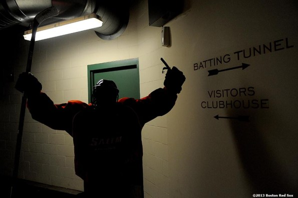 """""""A Salem State University player walk toward the batting tunnel between periods during a game against University of Massachusetts at Frozen Fenway Tuesday, January 7, 2014 at Fenway Park in Boston, Massachusetts."""""""