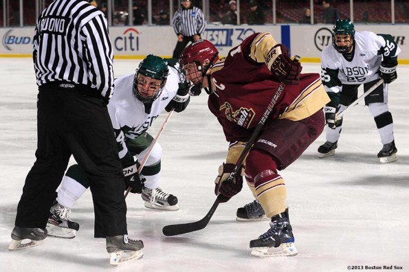"""""""Game action during a game between Babson College and Norwich University at Frozen Fenway Thursday, January 9, 2014 at Fenway Park in Boston, Massachusetts."""""""