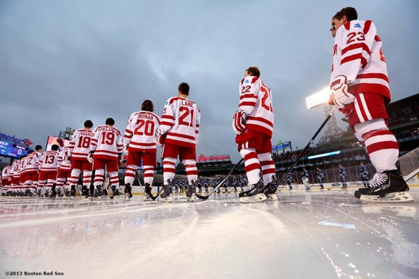 """""""Starting lineups are introduced before a game between University of Maine and Boston University at Frozen Fenway Saturday, January 11, 2014 at Fenway Park in Boston, Massachusetts."""""""