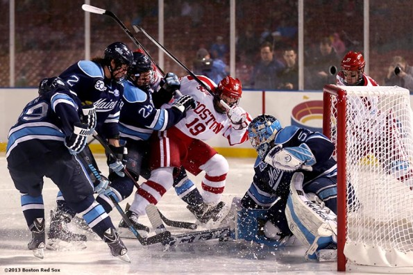 """""""Game action during a game between University of Maine and Boston University at Frozen Fenway Saturday, January 11, 2014 at Fenway Park in Boston, Massachusetts."""""""