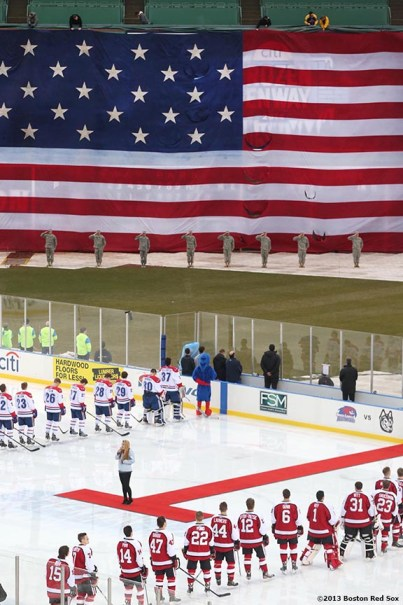 """""""The starting lineups are introduced before a game between University of Massachusetts Lowell and Northeastern University at Frozen Fenway Saturday, January 11, 2014 at Fenway Park in Boston, Massachusetts."""""""