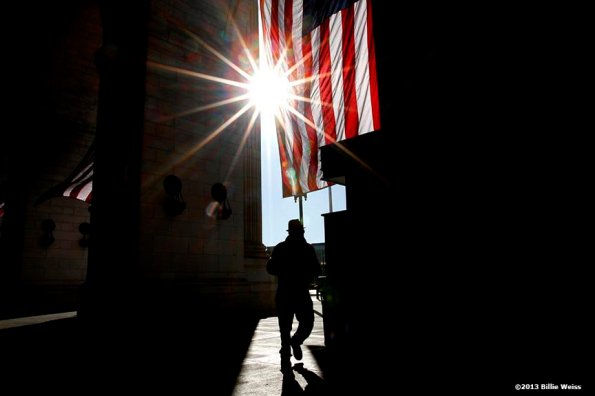 """""""The sun rises as a pedestrian passes by the entrance of Union Station in Washington, D.C. on the day before the 57th Presidential Inauguration Sunday, January 20, 2013."""""""