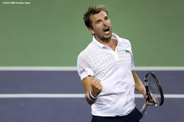 """""""Julien Benneteau reacts after defeating Dominic Thiem in the third round of the 2014 BNP Paribas Open Tuesday, March 11, 2014 in Indian Wells, California."""""""