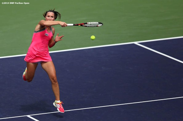 """""""Jelena Jankovic hits a forehand against Caroline Wozniacki in the fourth round of the 2014 BNP Paribas Open Tuesday, March 11, 2014 in Indian Wells, California."""""""